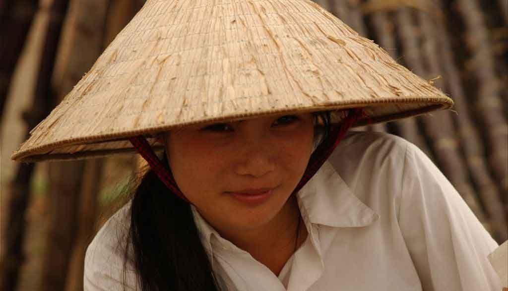 Vietnam Reisen - Die konischen Hüte findet man noch immer in ganz Vietnam